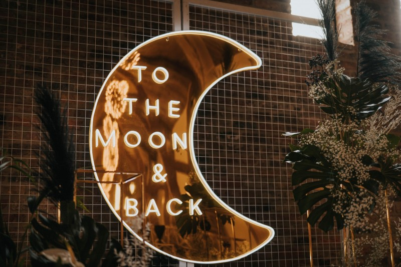 Stunning Neon Wedding 'to the moon and back' sign Hire